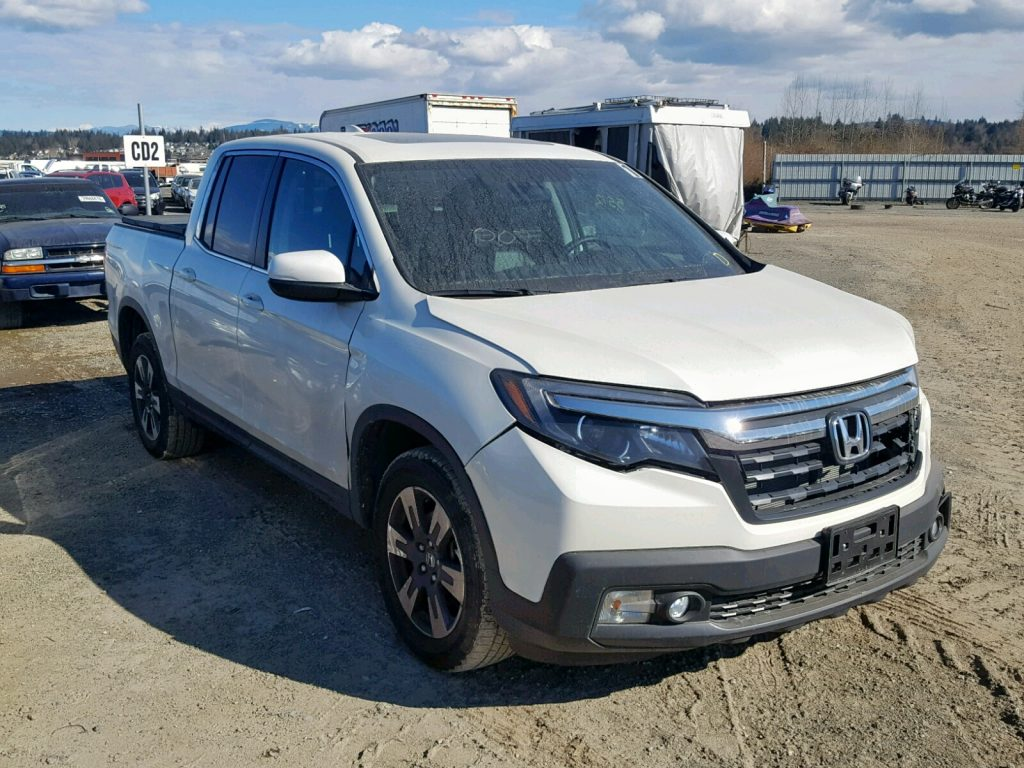 Damaged Honda Ridgeline Before Salvage Auction